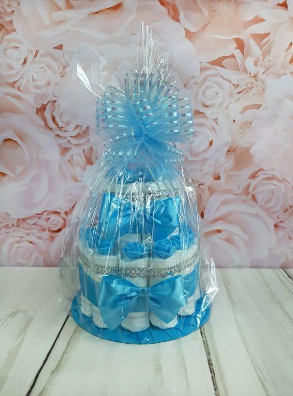pakitud sinine väike tort